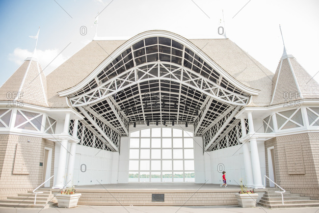 Boy running across stage of band shell