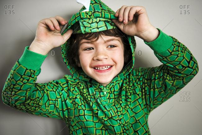 Boy in dinosaur pajamas