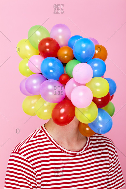 Person covered in balloons