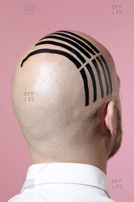 Man with abstract painting on head