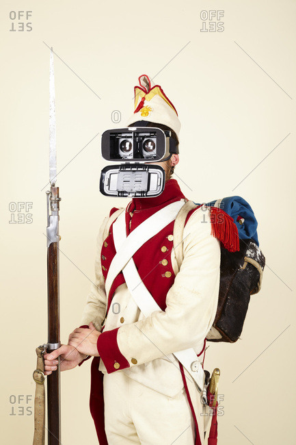 Man in revolutionary war costume with mask