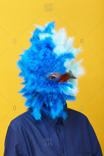 Person's face covered in feathers