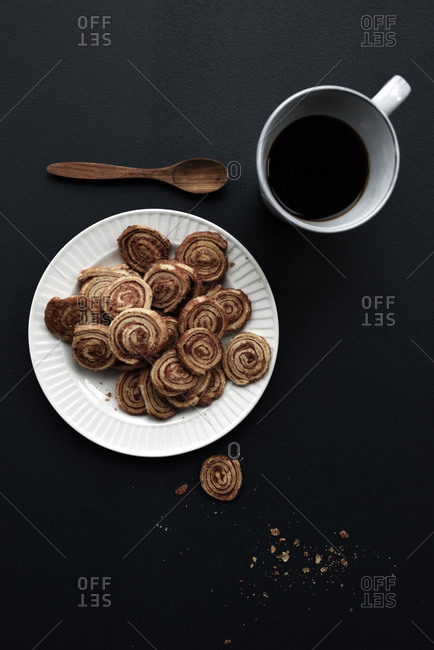 Cookies served on a vintage plate with coffee
