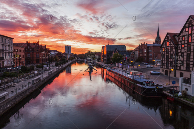 Poland, Kuyavian-Pomeranian, Bydgoszcz, Brda River, Dramatic sky reflecting in water surface