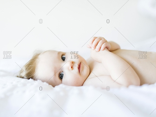 Portrait of baby girl (6-11 Months) looking at camera