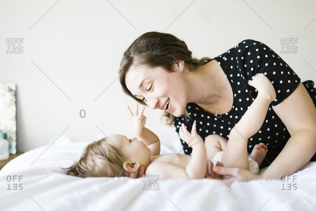 Baby girl (6-11 Months) playing with mother