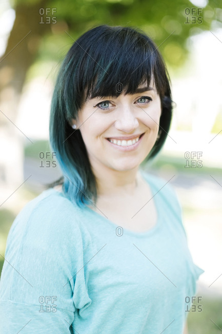 Portrait of smiling woman with blue ombre hair