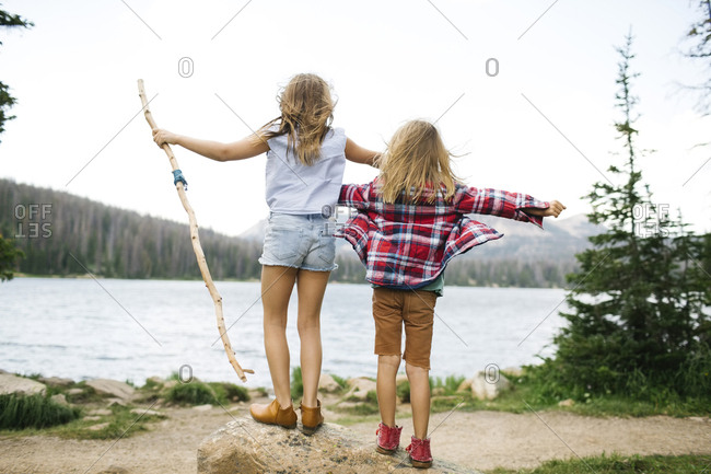 USA, Utah, Midway, Brother (6-7) and sister ( 8-9) standing by lake in forest