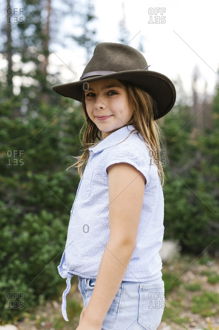 Outdoor portrait of girl (8-9) in hat