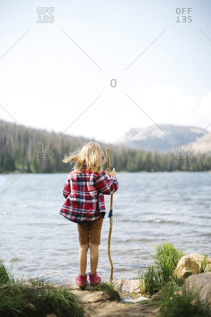 USA, Utah, Midway, Rear view of boy (6-7) standing by lake