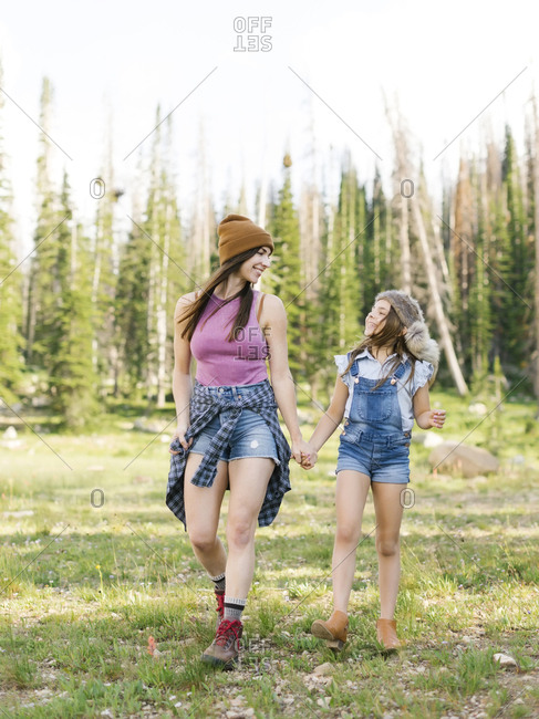 Mother with daughter (8-9) hiking in forest