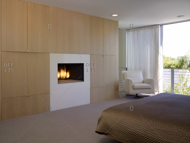 Modern bedroom with a fireplace