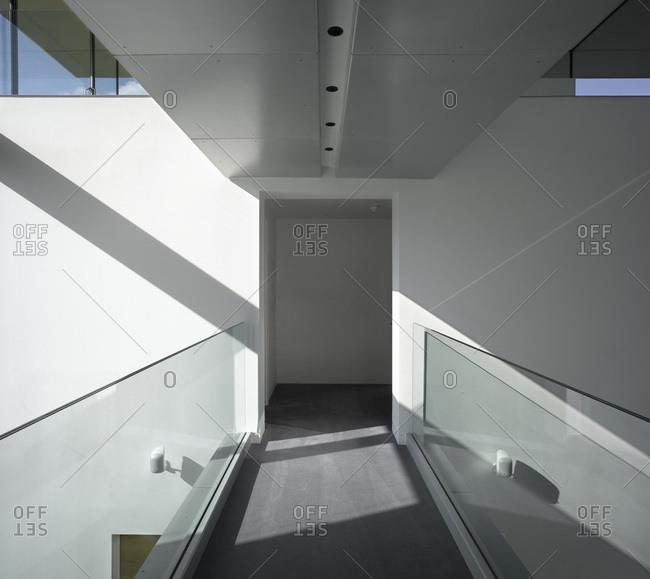 Sunlit atrium walkway in house, Dulwich, London, UK