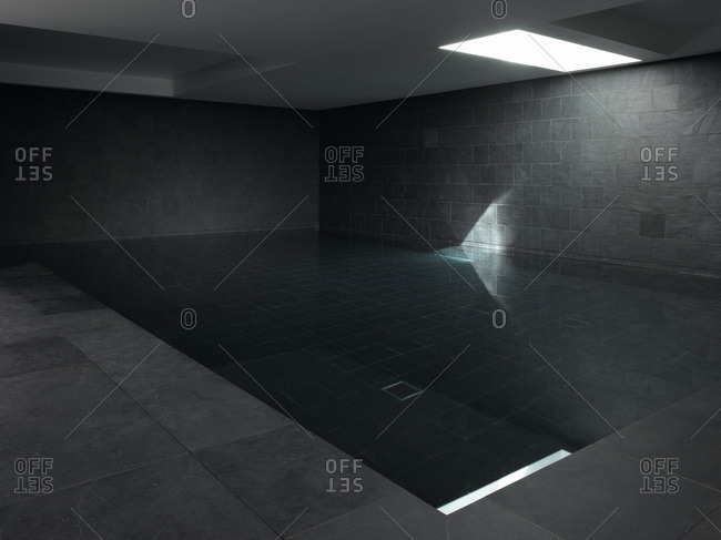 Stylish dark grey indoor basement swimming pool, Dulwich, London