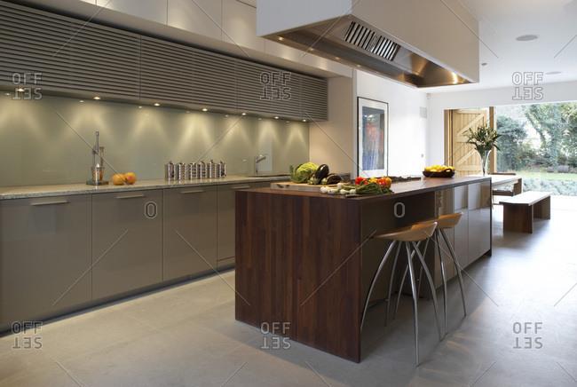 Modern open-plan kitchen with dark wood island unit, Dulwich, London