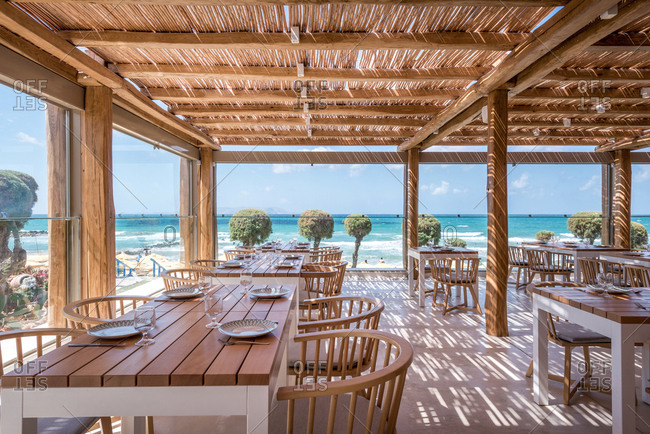 Interior view of dining hall of restaurant at beach resort and spa in Crete, Greece