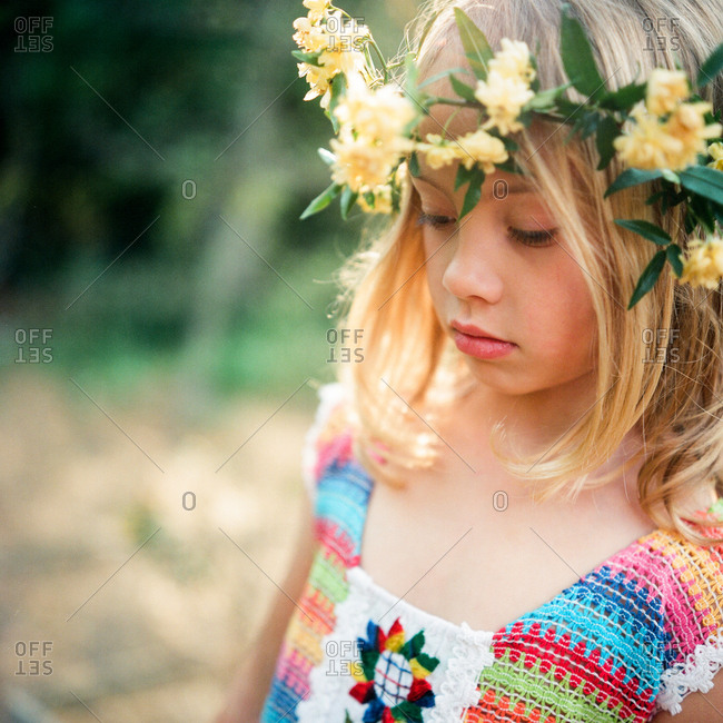 Portrait of a girl wearing a headpiece made of flowers