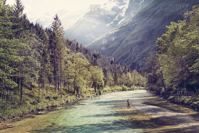 Slovenia- man fly fishing in Soca river