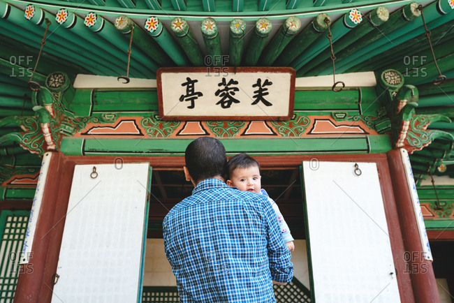 South Korea- Seoul- Father and baby girl visiting the Secret Garden in Changdeokgung Palace