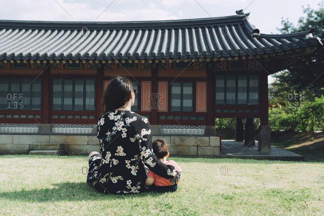 South Korea- Seoul- Mother and baby girl visiting Gyeongbokgung Palace