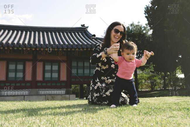 South Korea- Seoul- Mother and baby girl at Gyeongbokgung Palace