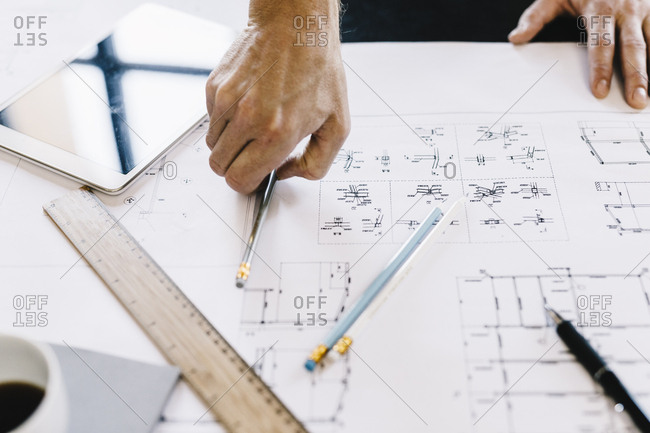 Architect working on construction plan- close-up