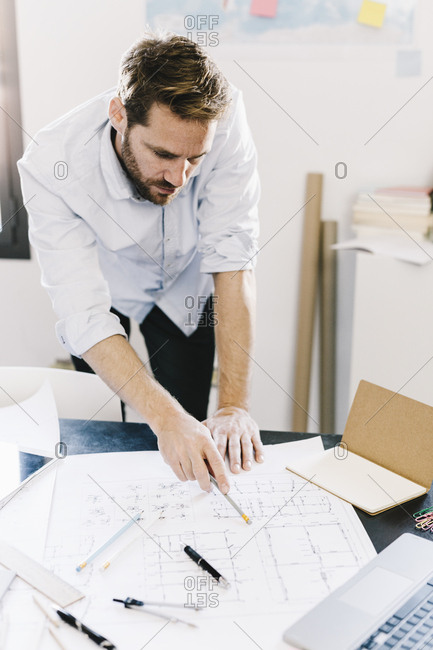 Architect working on construction plan