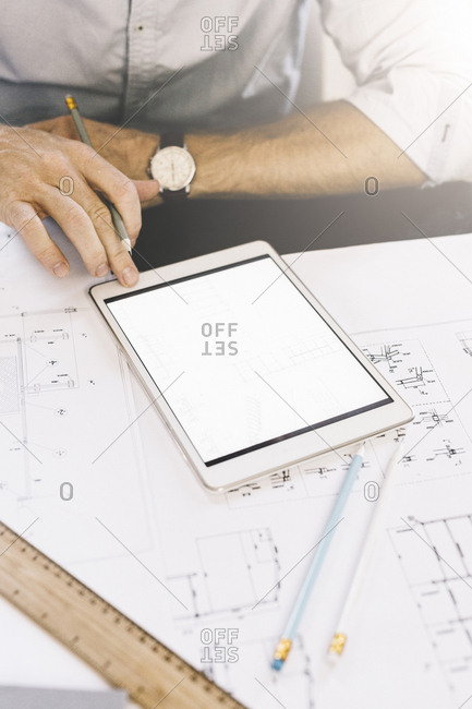 Architect working with tablet- close-up