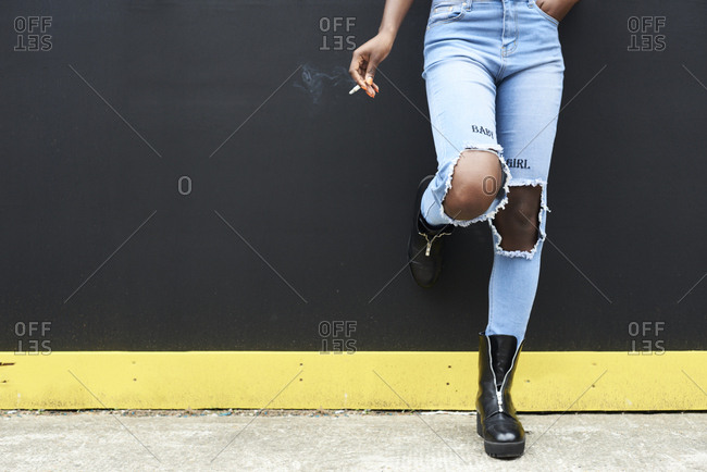 Legs of woman wearing used look jeans