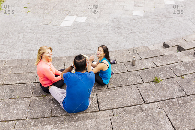 People relaxing on steps