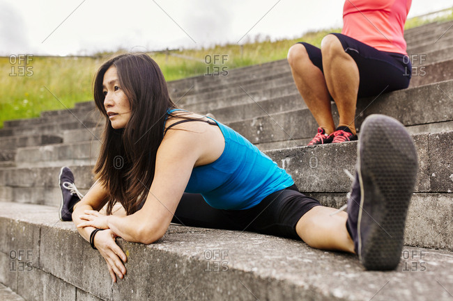 Woman doing split on steps