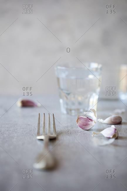 Close-up of a fork and garlic