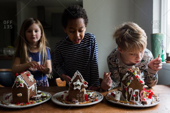 Three children with gingerbread houses