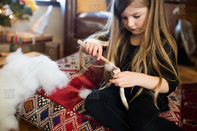 Girl stuffing fabric with cotton