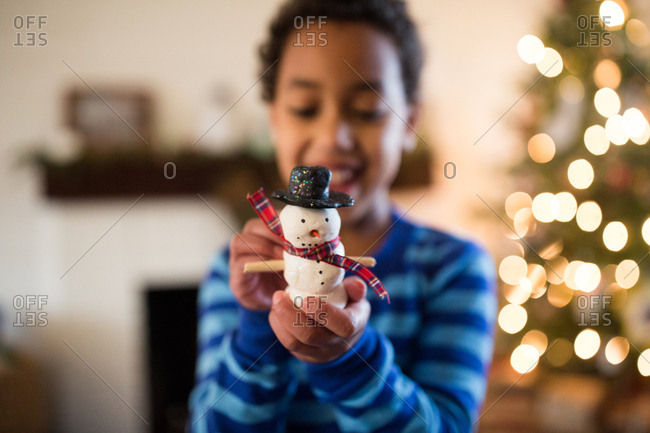Girl holding toy snowman