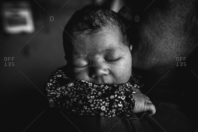Black and white portrait of mother holding baby