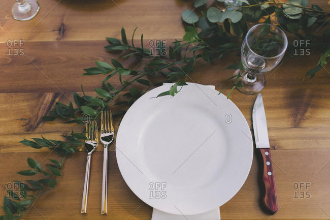 Place setting on outdoor table at a wedding reception