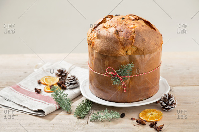 Italian Christmas cake panettone on wooden table with ribbon