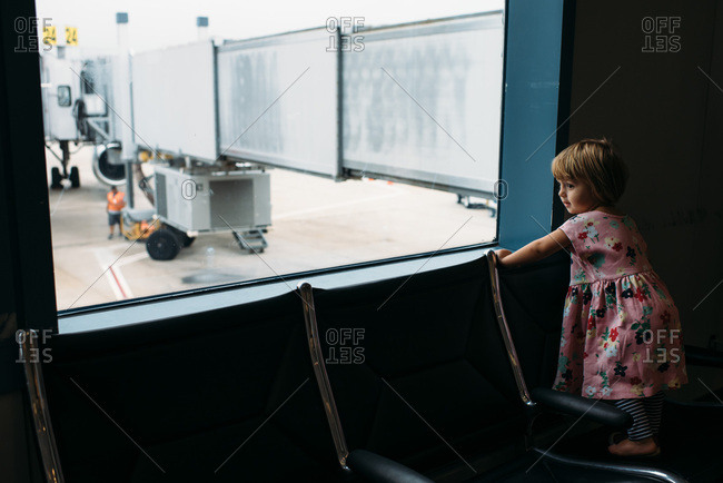 Toddler girl waiting in an airport