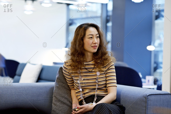 Woman in an office holding phone