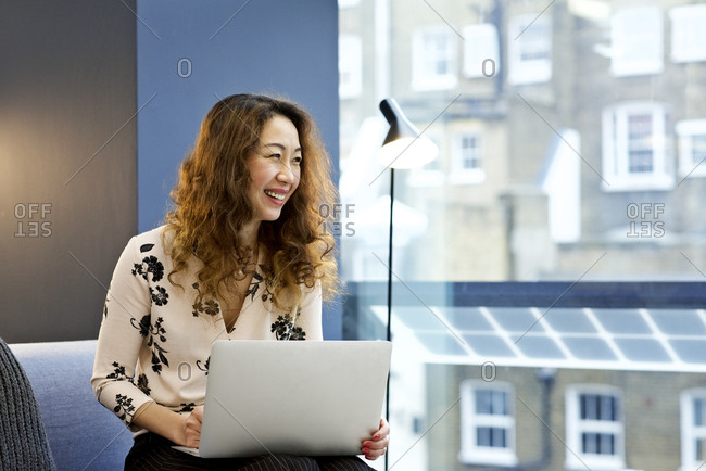 Smiling woman with a laptop