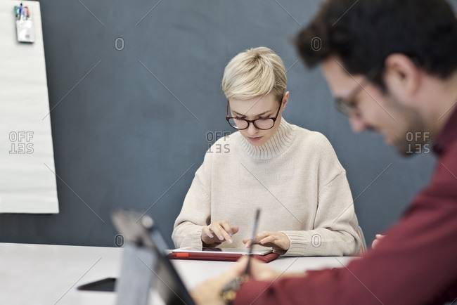 Coworkers using technology in meeting