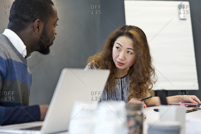 Woman listening to her male colleague