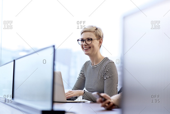Blonde woman smiling during a meeting
