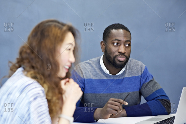 A man listening while in meeting