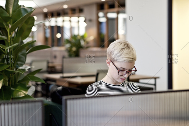 Woman working in open office
