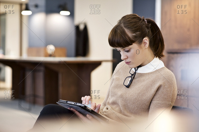 A woman on her tablet in office