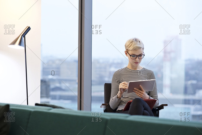 Woman in office with devices