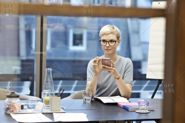 Woman at meeting desk with phone