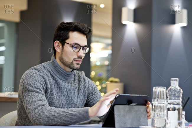 Portrait of man using tablet at work
